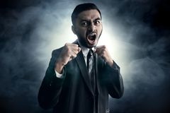 Business men angry on smoke background Royalty Free Stock Photo