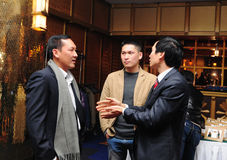 Business men attending a Year-end party Stock Photography