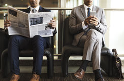 Business Men Break Sit Read Newspaper stock image