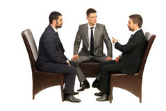 Business men on chairs having conversation royalty free stock photo