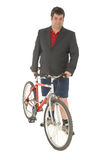 Business Men cycling to work. On suit and shorts Royalty Free Stock Images