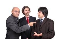 Business men debating Stock Images
