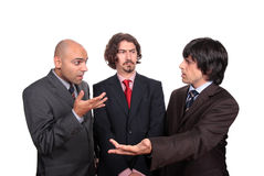 Business men debating Stock Images