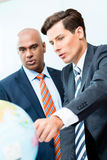 Business men discussing offshoring project Royalty Free Stock Image