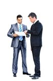 Business men discussing together Stock Images