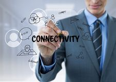 Business men drawing connectivity graphic. Digital composite of Business man drawing connectivity graphic Stock Photography