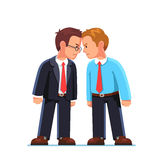 Business men enemies standing head to head arguing Stock Images