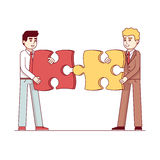 Business men gathering together puzzle pieces. Business men gathering together large puzzle pieces. Business metaphor of a joint venture, partnership or teamwork Royalty Free Stock Photos