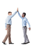Business men giving each other a high five Stock Photos