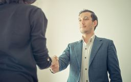 Business man gladly smile shaking hand with partner royalty free stock photography