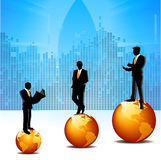 Business men on globes. Silhouette view of business men on globes Stock Photo