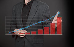 Business men hand pushing  graph Royalty Free Stock Image