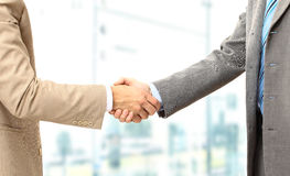 Business men hand shake Stock Photos