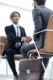 Close-up of a businessman holding a briefcase. Business men hands with briefcase Royalty Free Stock Image
