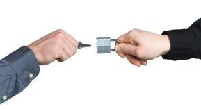 Business men hands locking a padlock Stock Photography