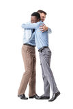 Business men happy embracing. Successful business men happy embracing isolated on white background. meeting friends Stock Photo
