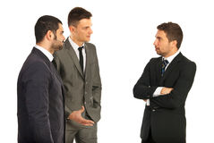 Business men having conversation. Meeting of three business men having conversation isolated on white background Stock Photography