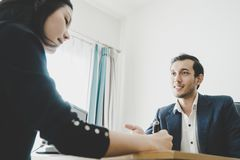 Business man inviting partner to sign a contract. Business men inviting partner to sign a business contract Royalty Free Stock Images