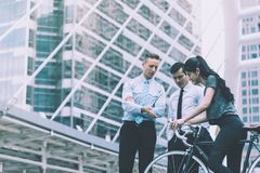Business man leading direction for a bicycle sport woman in c royalty free stock images
