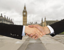 Business men in London. Handshake of a woman and business men in London Stock Photos
