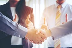 Business men making handshake, Partnership congratulation, merge. R and acquisition concepts, Vintage tone Retro filter effect, soft focus, office background stock photography