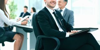 Business man at office with his business team working behind stock photo