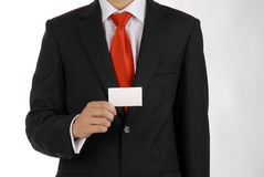 Business men presents his business card. The men holds blank business card which can contains information of you company stock photos