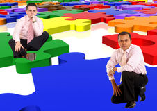 Business men with a puzzle Royalty Free Stock Photos