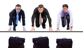 Business men racing for briefcases Royalty Free Stock Photography