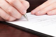 Business men reading contract. Stock Photography