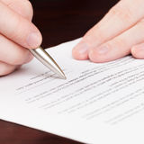 Business men reading contract - 1 to 1 ratio Royalty Free Stock Photos