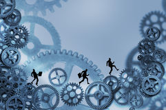 Business Men Running On Gears Stock Photography