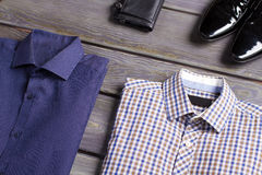 Business men's shirts, shoes and purse. Royalty Free Stock Photography