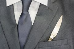 Business men`s suit. In the pocket lies a knife. It`s lunch time Royalty Free Stock Image