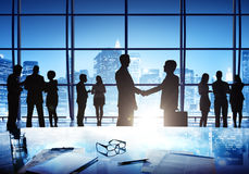 Business Men Shaking Hand In The Middle Of The Crowd In A Office Stock Images
