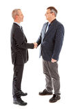 Business men shaking hands. Over white background Stock Photo