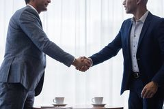 Business men shaking hands with each other after a deal. Two business men shaking hands with each other after a deal. Businesspeople shaking hands making a Stock Images