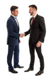 Business men shaking hands. Elegant business men shaking hands and smiling. Successful cooperation concept on white studio background Stock Image