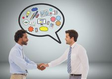 Business men shaking hands with speech bubble of business graphic drawings Royalty Free Stock Photos