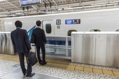 Business men Shinkansen train Japan. Business men waiting to board Shinkansen train at Kyoto Station, Japan. Shinkansen lit. `New Trunk Line`, in English called Royalty Free Stock Photography