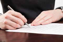 Business men signing contract. Business man signing contract with silver pen Royalty Free Stock Image