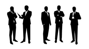 Business men silhouettes set in various poses Royalty Free Stock Photo