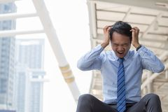 Business men are stressed. Business man are stressed in city background stock images