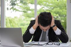 Business men are stressed with work. Business man are stressed with work in office stock image