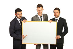 Business men team with banner. Happy business men team holding blank banner isolated on white background Royalty Free Stock Photos
