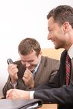 Business men team during negotiations - good news Stock Image