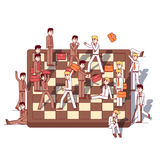 Business men teams fighting on giant chessboard Royalty Free Stock Photography