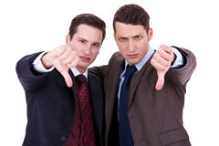 Business men with thumb down gesture Royalty Free Stock Photography