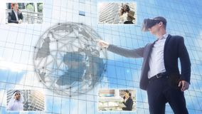 Business man using VR headset and interacting with object world. A business men using VR headset and interacting with object world display and connect to people Stock Image
