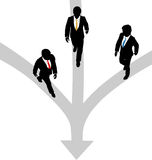 Business men walk 3 paths together toward one. Three business people walk paths to join together at one Stock Images